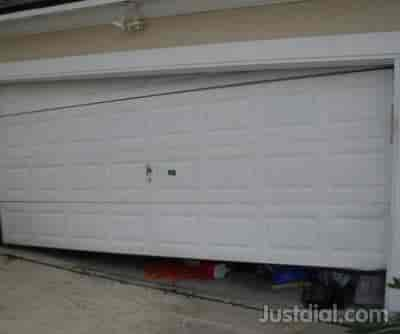 DAVID VOGAL GARAGE DOOR REPAIRS 10476 Anchorage Cove, Jacksonville, FL    32257 1of6